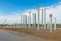 Consruction site with  precast concret pile and pile-driver Royalty Free Stock Image