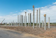 Consruction site with  precast concret pile and pile-driver Stock Images