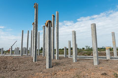 Consruction site with  precast concret pile and pile-driver Stock Photos