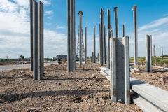 Consruction site with  precast concret pile and pile-driver Stock Image