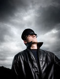 Constable under stormy skies. Fashion model becomes police inspector Stock Image