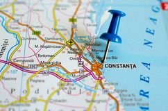 ConstanÈ›a on map. Close up shot of Constanța on map with blue push pin stock photo