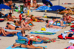 CONSTANTA, ROMANIA - AUGUST 21, 2010. Beach with tourists, a top view Royalty Free Stock Photos