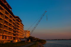 CONSTANTA, ROMANIA - AUGUST 21, 2010. Construction of high-rise house on the lake Royalty Free Stock Photography