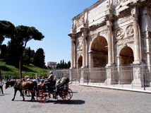 Constantin Arch. World famous Constantin arch and horse cart on a sunny sunday day in Rome, Italy Stock Photo