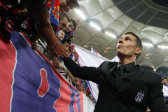 Constantin Galca. Steaua Bucharest coach, shaking hands with the supporters at the end of the football match between Steaua Bucharest and Aktobe, 6th August Royalty Free Stock Photography