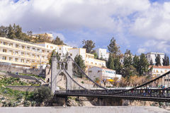 CONSTANTINE, ALGERIA - MARCH 07, 2017: The suspension bridge or footbridge of Sidi M Cid crosses the gorges 175 meters above the c. Liff. Designed by the Royalty Free Stock Image