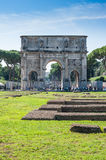 Constantine Arch old roman architecture monument. In sunny day and tourists walking around Royalty Free Stock Image