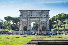 Constantine Arch old roman architecture monument. In sunny day and tourists walking around Stock Photos