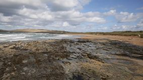 Constantine Bay Cornwall England UK Cornish north coast between Newquay and Padstow. On a sunny blue sky day with white clouds PAN stock video footage