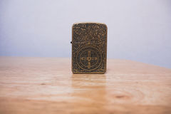 Constantine zippo lighter on a table Royalty Free Stock Photos