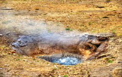 Constantly boiling Litli Geysir in Iceland Royalty Free Stock Photography