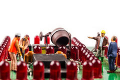 Constantly doing the best regarding fixing the electronics. Fixing the problem concept, closeup of miniature figurine of workers repairing mainboard of royalty free stock photos