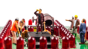 Constantly doing the best regarding fixing the electronics. Fixing the problem concept, closeup of miniature figurine of workers repairing mainboard of stock image