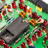 Constantly doing the best regarding fixing the electronics. Fixing the problem concept, closeup of miniature figurine of workers repairing mainboard of stock images