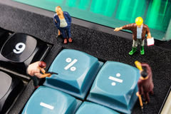 Constantly doing the best regarding interest rates. Constantly changing interest rates / fixing the problem concept, closeup of miniature figurine of workers royalty free stock photos