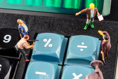 Constantly doing the best regarding interest rates. Constatly changing interest rates / fixing the problem concept, closeup of miniature figurine of workers stock image