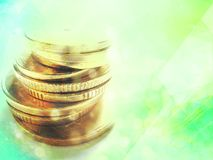 Constantly growing capital. Gold coins composed one on another to a tower on a soft green background stock photos