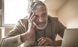 Constantly new problems. Senior businessman in his office royalty free stock photography