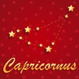 Constelação Capricornus sobre o fundo estrelado vermelho fotografia de stock