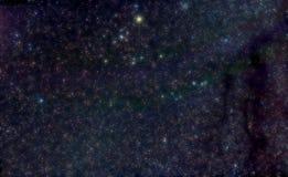 Constelación del tauro con las nubes de polvo galácticas Imagen de archivo