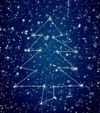 Constellation Christmas tree in snowy sky royalty free stock images