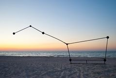 Constellation Ursa Major sculpture on the beach sea evening Stock Images