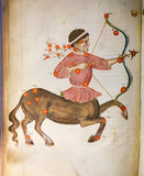 The constellation Sagittarius in an astrology text. Depiction of the constellation Sagittarius in an antique astrology text in the Library of Prague, Czech Stock Photography