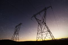 Composite image of constellation of stars. Constellation of stars against the evening electricity pylon silhouette stock photo