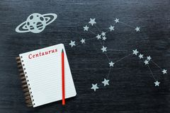 Constellations Centaurus. Zodiacal star, constellations Centaurus on a black background with a notepad and pencil stock photo