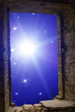 Constellations supernova ancient window. The sky with stars and some supernova star visible through an old ancient stone window Stock Photo