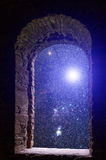 Constellations supernova ancient window. The sky with stars and some supernova star visible through an old ancient stone window Royalty Free Stock Photography