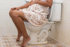 Constipation in pregnant women. In toilet Royalty Free Stock Photography