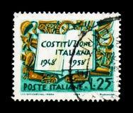 Constitución y símbolos italianos del trabajo, anneversa de diez años Imagen de archivo libre de regalías
