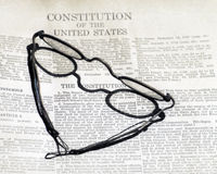 Constitution. Antique glasses resting on a copy of the Constitution of the United States royalty free stock image
