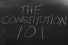 The Constitution 101 On A Blackboard. The words `The Constitution 101` on a blackboard in chalk Stock Photos