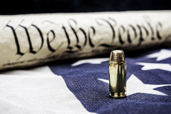 Constitution and bullet Royalty Free Stock Photos