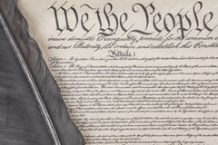 Constitution Crop with Feather Pen. Close crop of the preamble to the United State`s Constitution with an eagle feather pen Royalty Free Stock Image