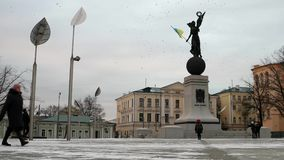 Constitution square in Kharkiv, flag on monument, timelapse. Constitution square in Kharkiv, Ukraine, blue and yellow flag waving on a monument, timelapse stock video footage