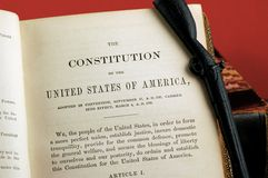 Constitution of the United States. Open in a book with revolutionary rifle nearby Stock Photo
