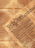 Constitution of the United States. Part of the preamble of the constitution of the United States of America laying on top of the backside of this historical Royalty Free Stock Images