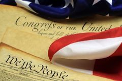Constitution of the United States - We The People. Preamble to the Constitution of the United States and American Flag Stock Photos