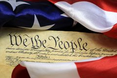 Constitution of the United States - We The People. Preamble to the Constitution of the United States and American Flag Royalty Free Stock Images