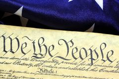 Constitution of the United States - We The People. Preamble to the Constitution of the United States and American Flag Royalty Free Stock Photo
