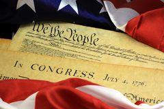Constitution of the United States - We The People. Preamble to the Constitution of the United States and American Flag Stock Image
