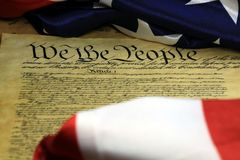 Constitution of the United States - We The People. Preamble to the Constitution of the United States and American Flag Royalty Free Stock Image