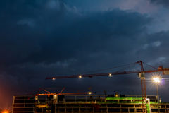 Constraction site with a crane at night Royalty Free Stock Image