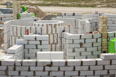Constraction workers building a roundhouse with aerated autoclaved concrete blocks. Royalty Free Stock Photos