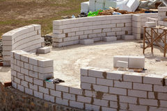 Constraction workers building a roundhouse with aerated autoclaved concrete blocks. Stock Image