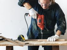 Constractor handyman working and using screwdriver Royalty Free Stock Image